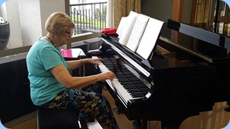 Kay Boyes playing the K. Kawai grand piano