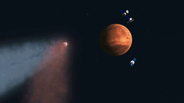 Seeding life: An artist's concept of a comet approaching Mars, as orbiters prepare to make observations. Picture: REUTERS