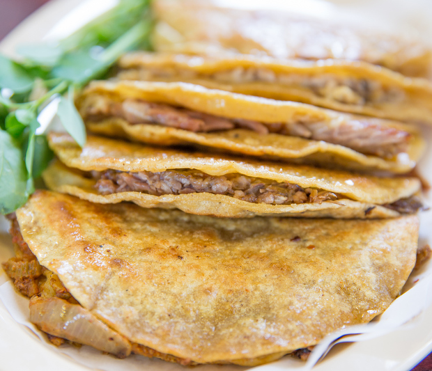 photo of grilled tortillas filled with meat