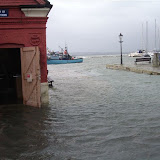 Flooding at high tide and with a westerly gale - Easter 2008 - it's hard to see where the harbour ends and the quay begins!