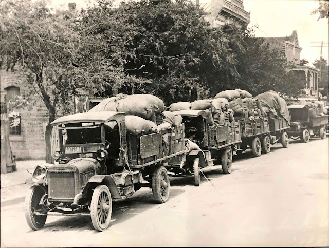 wool laden trucks, Kerrville, 1921