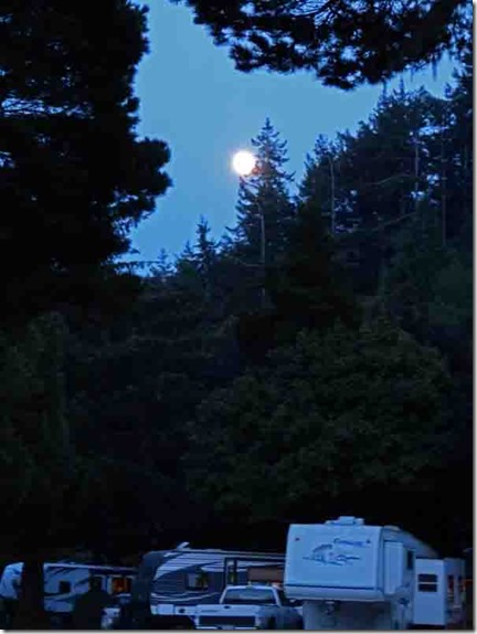 Moon rising from east as nightfalls, Indian Creek, Gold Beach, OR