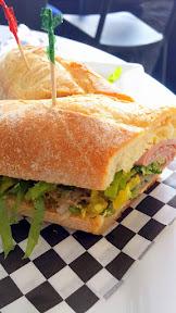 Marmo PDX sandwich of Italian Sub with Mortadella, finocchiona, spicy coppa, shredded romaine, provolone, pepperoncini, red onion, oregano, aioli, Italian vin, all on a roll