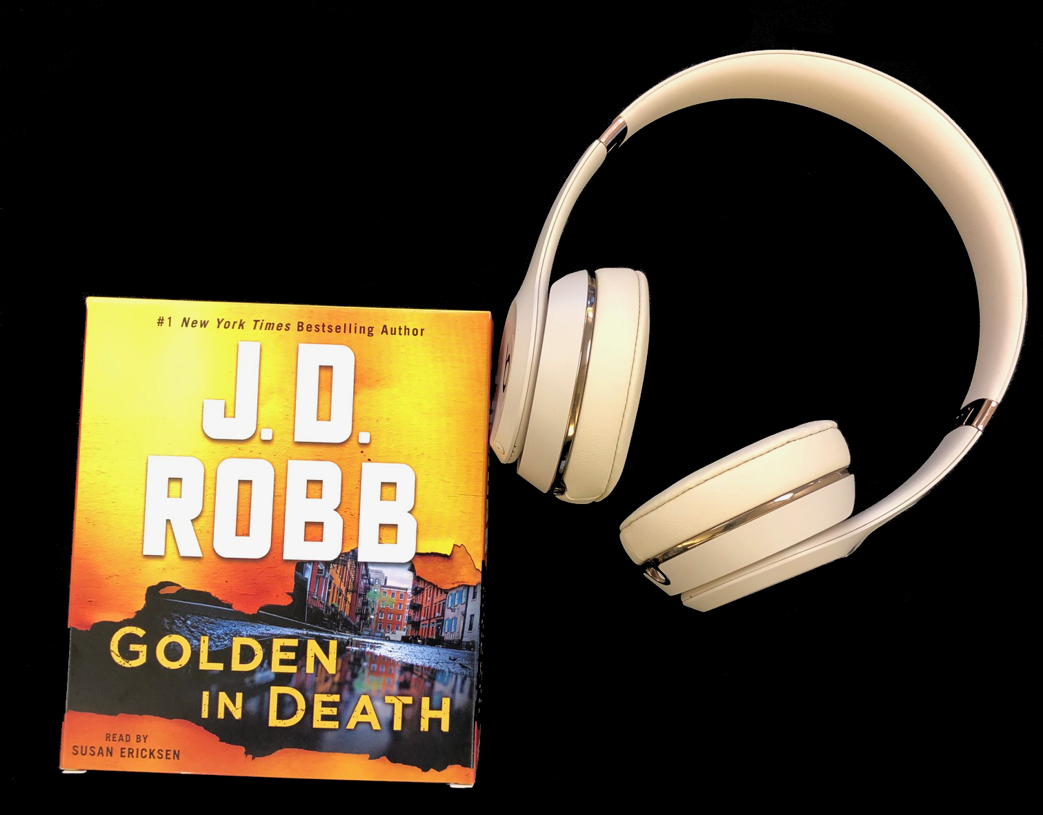 Golden in Death audiobook and headphones