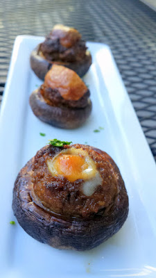 Pink Rose Restaurant happy hour option of the Chorizo Stuffed Mushrooms with Painted Hills beef house chorizo and Manchego cheese