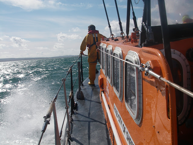 4 September 2011 - Crew Member onboard Poole's Tyne class lifeboat searching for missing swimmers. Photo: RNLI/Poole lifeboat