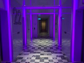 YOTEL lift lobby in purple