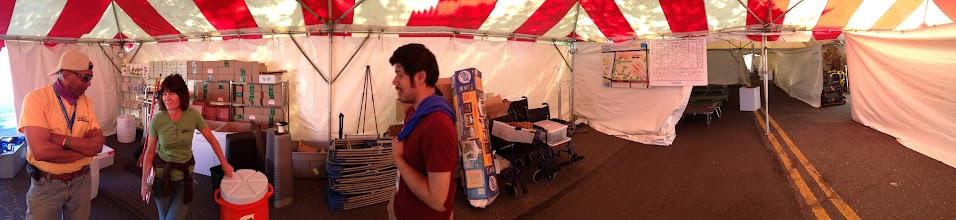 Photo: Volunteer Coordinator Joe Caesar, Director of Stewardship Barbara McCabe and VISA Charles Bouril in the medical tent pre-race