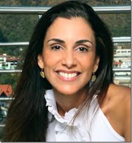 Mônica Veloso, jornalista e apresentadora de televisão