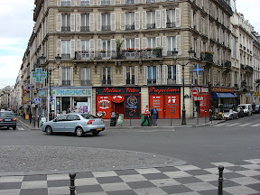 I love the architecture in Paris.  This was an interesting area - sex shops mixed with upscale apartments and sidewalk cafes.  This is across from The Moulin Rouge.
