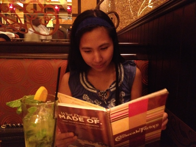 Lady in Cheese Cake Factory Dubai Mall