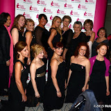 WWW.ENTSIMAGES.COM -   The choir with Camilla Kerslake   at    Breast Cancer Campaign's Pink Ribbon Ball at The Dorchester, 55 Park Lane, London October 12th 2013                                                    Photo Mobis Photos/OIC 0203 174 1069