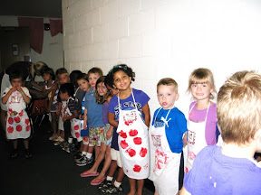 Small children lined up sweetly?