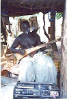 Mali, West Africa. Chief of the Dogon Village playing my backpacker guitar.