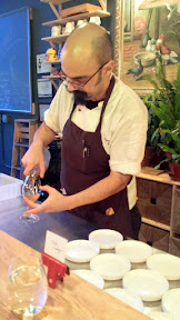 Chef Rico pouring the Earl Grey Kombucha