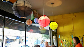 A peek at Elena of Nodoguro PDX on the bottom right and some of the colorful lanterns in the Evoo space