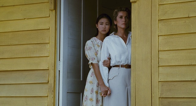 Linh Dan Pham is Camille and Catherine Deneuve is Eliane in Indochine (1992)