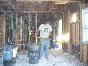 Cleaning out the construction debris from Richey's house