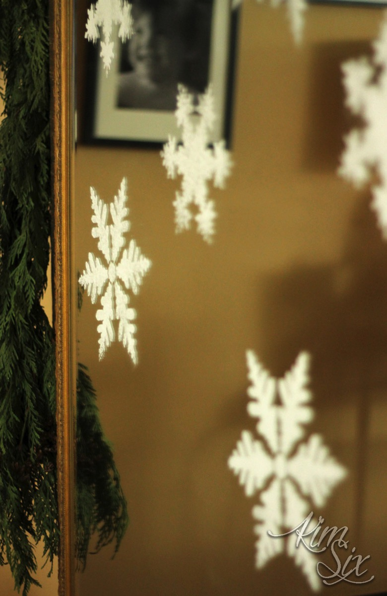 Snowflakes stenciled on mirror