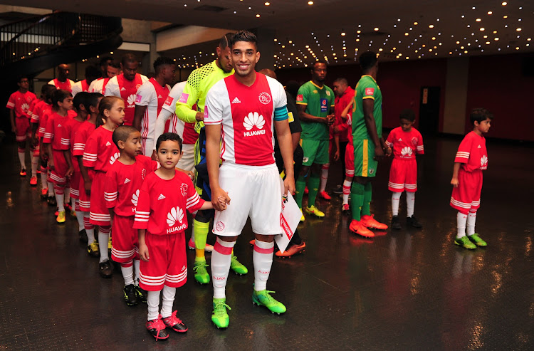 Travis Graham of Ajax Cape Town and the club's mascots during the Absa Premiership 2016/17 game against Baroka FC at Cape Town Stadium on 27 May 2017.