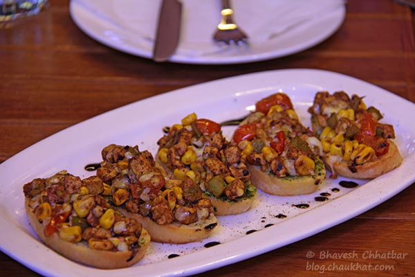 Italiano Backyard Bruschettas Platter made with Ciabatta Bread, served at Toss Sports Lounge Koregaon Park