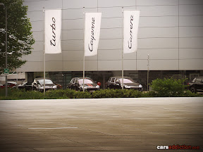 More Porsche Cayanne Turbos on display outside.