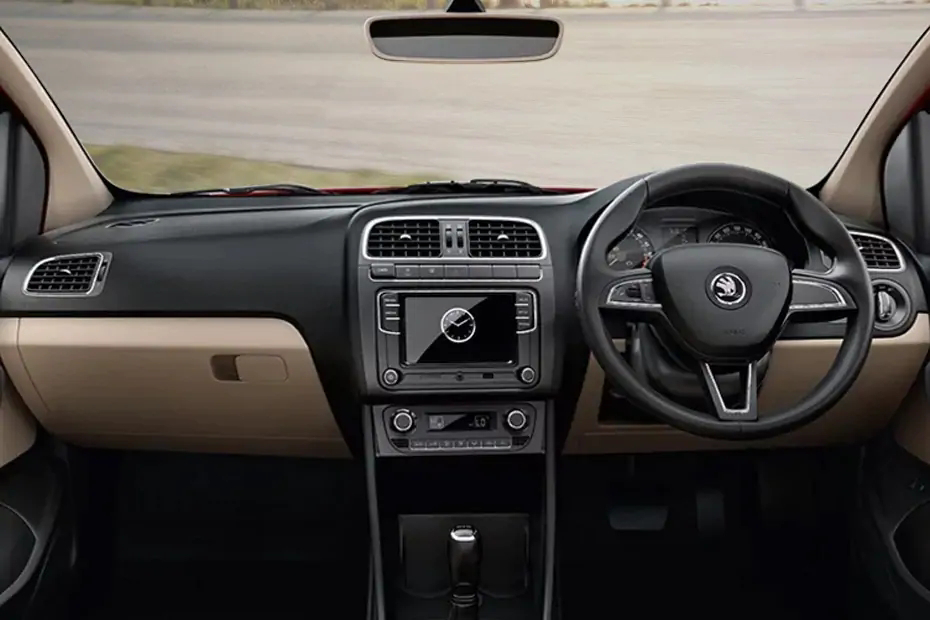 This image shows the ebony colored interior of skoda rapid rider plus with off white seat covers and texture