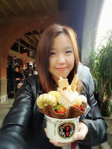 Happy girl and jumbo Miyahara ice cream in Taichung