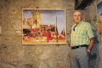 Juanjo Aretxederreta junto al cuadro de Villamorón en la exposición de Villadiego 2013