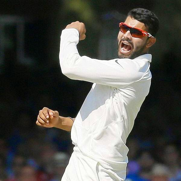 India's Ravindra Jadeja celebrates the wicket of England's Joe Root during the second day of the second test match between England and India at Lord's cricket ground in London, Friday, July 18, 2014.
