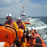 Poole ILB tows a motor vessel with fuel and engine problems back towards Rockley Point in Poole Harbour.  Featured are Steve Porter (helm) and Mark Ponchaud. 23 July 2014.  Photo credit: Dave Riley