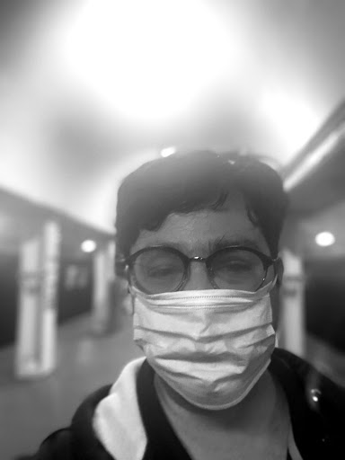 Greig Roselli wears a surgical mask while traveling on public transit in Chicago, Illinois