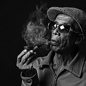 smoker by Alis Riezman - People Portraits of Men