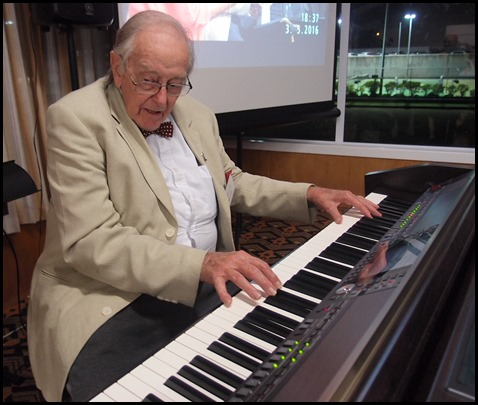 Merv Adair giving the Clavinova a 'whirl' prior to the start of the evening's programme. Photo courtesy of Dennis Lyons.
