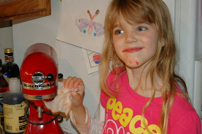 Batter Faced Girl Cleaning the Mixer