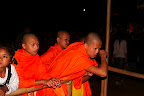 Monks playing a bottle game