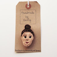 handmade by emily embroidered brooch bun brown hair lady felt
