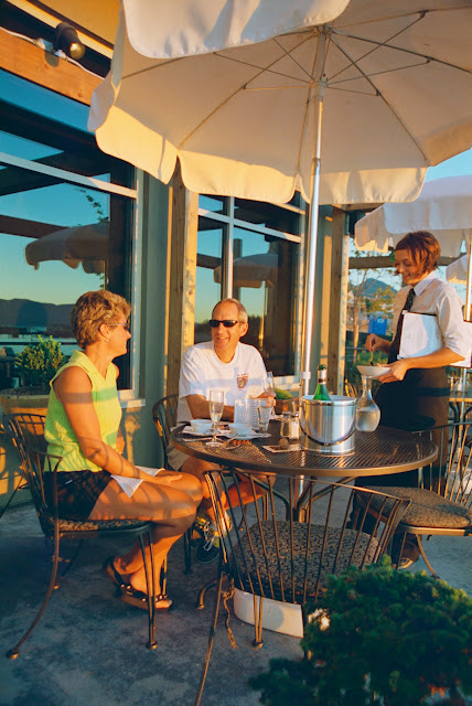 Guests enjoy outdoor seating and fine delicacies at Fino Wine Bar. / Credit: Danny Lauve