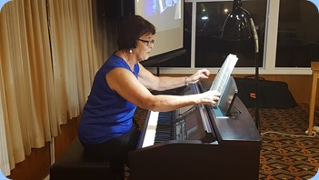 Our new Club Treasurer, Mary Elvin, playing the Club's Clavinova CVP-509. Photo courtesy of Rod Moffat.
