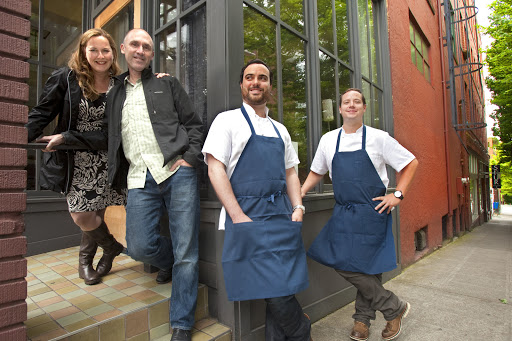 Scott and Heather Staples, left, owners of Restaurant Zoe in Belltown and Brian McCracken and Dana Tough, owner/chefs of Spur Gastropub also in the Belltown neighborhood of Seattle stand in front of Zoe which will be moving to Capitol Hill while McCracken and Tough take over its location with a new restaurant. [SEATTLE TIMES/MIKE SIEGEL]