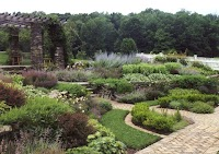In Rhinebeck, N.Y., stone walls and brick paths create   structure for a perennial garden