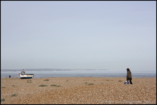 Woman and horizon on Dungeness beach