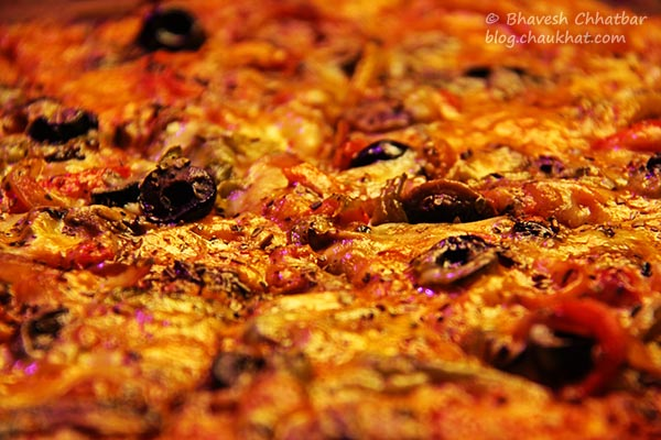 Close-up of Lot Veg Pizza at The Flying Saucer Sky Bar, Viman Nagar, Pune