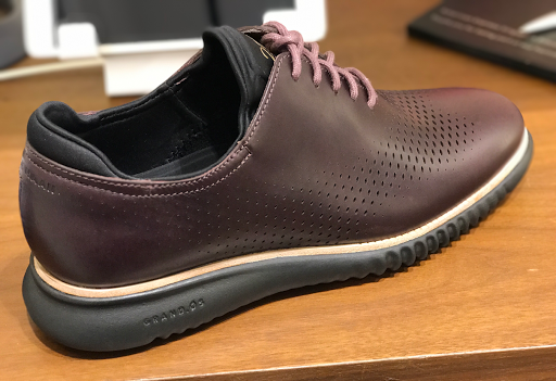 The deep upper leather and sole colors make it very suitable for business  meetings, while maintaining that edgy, unconstrained Cole Haan character.