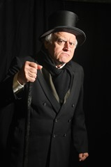 Alan Semok as Scrooge