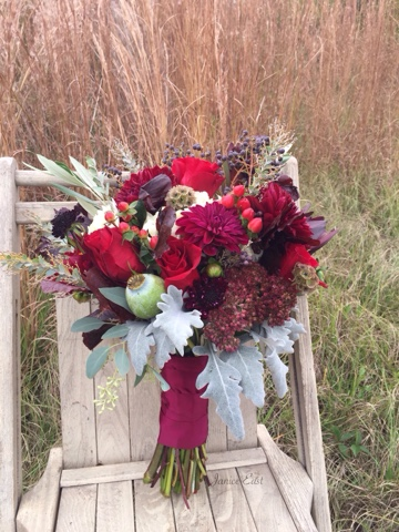 burgundy roses, dahlias, assorted foliage and berries