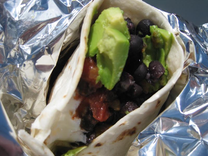 Rice and bean burrito with avocado