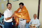 T.N.K.Kumaresh EBST Trustee presenting Shawl to Dr.G.A.Viswanathan :: Date: Feb 17, 2008, 11:27 AMNumber of Comments on Photo:0View Photo