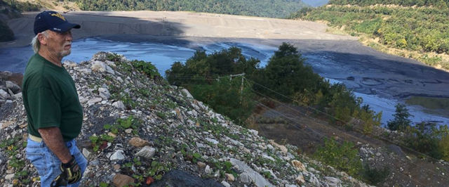 In this Tuesday, 26 September 2017 photo, former coal miner Chuck Nelson looks out on the Brushy Fork impoundment in Raleigh County, in southern West Virginia, an estimated 2.8 billion gallon coal slurry containing sludge and chemicals from nearby surface mines. He says the slurries pollute the groundwater and contribute to high rates of cancer and other illnesses among the people living nearby. Photo: Michael Virtanen / AP Photo