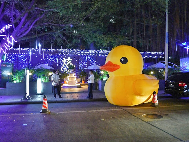 large inflatable duck in front of a bar in Zhuhai